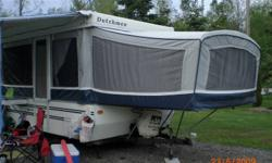 1995 Dutchman Tent Trailer For Sale $3800.00 ORB Queen size bed at one end, Double at the other. The table folds down for a bed as well. Working furnace and fridge. Easy to tow behind a mini- van