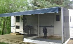 2001 Dutchmen Lite 26 RL Rear livingroom large picture window, dinette, kitchen. 4 pc bathroom, queensize bed, separate bedroom. Screen room 8'x9' no more mosquitos. 12' slide out, full length awning. Everything works. Great trailer. Set up on a site on