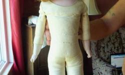 2 antique dolls that have been restored to museum quality.  They are in decent shape considering the age of them.  The mid size doll has a kid leather body, porcelain hands and feet as well as head.  Her eyes open and close.  On her neck is: Made in