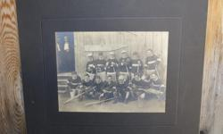 Early 20th century sepia-tone lacrosse photo with matte - there's no team or city name on this vintage framed photo but the caps and equipment would indicate this is from the early 20th century. This unique piece of early Canadiana highlights our national