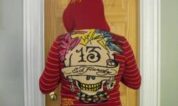 Gorgeous women's zip-up hooded sweater by sought after company, Ed Hardy. Designed by Christian Audigier, size small, but would fit up to a medium. Eye-catching skull design with gold detailing on the back and subtle sequinned motif running down the