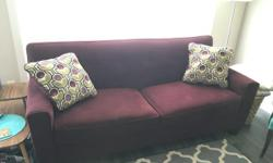 """Gorgeous couch in Eggplant, from Ashley Furniture. Great condition, no rips or stains. Very comfortable! Dark brown wooden legs. Comes with two pillows shown in picture. One side has design and the other is the same material as couch. Sofa is 79"""" wide x"""