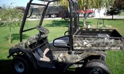 excellent condition    electric golf cart    camo    with tilt box