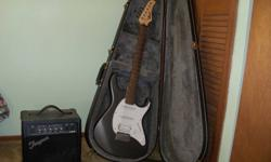 Cort electric guitar for sale. Played very little and in very good condition. Has a tremblo bar and is about 7 years old. Comes with 10 watt amp, case, cord, and set of strings. $150.OBO.