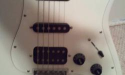 Excellent condition! This guitar is great for beginners. Soft case and strap included.