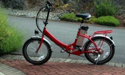 """Bright red electric folding bicycle (20"""" wheels) for sale, step-through frame. 250W brushless motor, Shimano 6-speed derailleur, 36V 10AH lithium battery with charger. Bought new in May 2015 but never used. $1,245.00. No bike rack required as it folds up"""