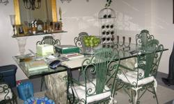 Elegant French tempered glass table top with 2 ceramic lion pedestals!  Comes with 6 beautiful and sturdy wrought iron chairs!  Each chair has a soft white cushion.  No chips or visible scratches!  Originally paid over $3000 brand new!  Was asking $1000,