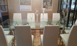 >100 INCHES LONG X 50 INCHES WIDE GLASS TABLE > 3/8 INCHES THICK GLASS >CHROME BASE >10 WHITE LEATHER CHAIRS WITH CHROME LEGS **CHAIRS WILL NOT BE SOLD SEPARATELY** EXCELLENT CONDITION!!! ONLY USED 3 TIMES! BEAUTIFUL ADDITION TO ANY DINING ROOM! $1900.00