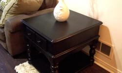 "I have an elegant large black colonial style end table for sale. Made of solid oak and very heavy. Has beautiful detail on all the sides. Only one for sale. In great condition. Measurements are 25""width x 28""deep x 25"" high. Its VERY LARGE so make sure"
