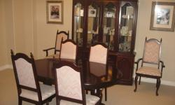 The dark cherry stained dining set includes: 2 taupe covered armed chairs 4 taupe covered regular chairs Table 42 W x 64 L 2 pc Hutch 18 W x 64 L x 86 H all 4 glass doors open 2 upper lights great condition non-smoking home $450 or best reasonable offer