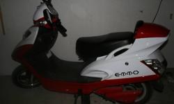 We bought this brand new E-bike for $1300 in July 2011 at Green Street. It is red and white. It is in perfect condition, only gently used since it was purchased. Comes with a white helmet. Goes up to 34 km/hr and you can get 80 km on one battery charge,
