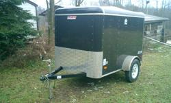 """Enclosed Cargo trailer 5'x8' Black with 24"""" stone guard on front single spring axle 2990 Non powered roof vent with lid. 1 12v wall switch and interior dome light single rear door with bar lock standard hitch 2"""" coupler with jack   Pace American"""