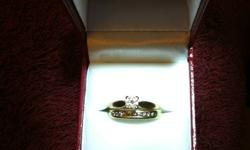 Beautiful yellow gold wedding ring set.  Engagement ring is 14K gold and the solitaire diamond is 0.39ct.  Its clarity is I-1.  I have an appraisal for the engagement ring at $2300 which will be included with the purchase.  The wedding band is also 14K