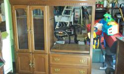 E.C. is 54 inches wide, 56 inches high, made from solid Oak and Veneer. Two drawers and t.v. opening on one side, opening is 26,3/4 wide.Two large doors up and two smaller doors below, in good condition.  Call 569-4705