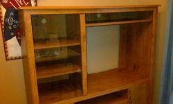 """Good condition, sturdy unit.  Storage drawer, and 2 bottom cupboards.  Will hold tv up to 32"""".  Pick up only."""