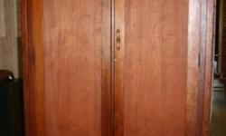 """Wardrobe Converted to Entertainment Center Large Solid Cedar Wardrobe Made in Canada around 1930. Very Nice and Unique 48? wide 25? deep 80"""" tall Inside width is perfect for a 47? flat screen TV. I had a surround sound system and all components on"""