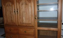"""Older entertainment center for sale for $120.00.  In very good shape. If you want to look at it, email me or call tina at 403-529-1182.  4' TALL, and 20"""" deep, and 4' 6"""" wide."""