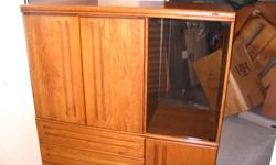 """Entertainment centre excellent condition made by Palliser It has room for a 30"""" TV. It measures 55"""" long x 20"""" deep. It is on wheels easy to move."""