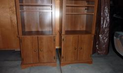 """Entertainment Towers - Two - Aspen Oak Wood Cabinets (Talon Systems) Two - Each has two bottom doors (with one shelf inside) and two top adjustable shelves Measurements :- Height = 48"""", Width = 24"""", Depth = 16"""" Excellent like new condition $85.00 O.B.O."""