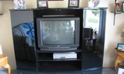 Black entertainment unit with smoke glasses doors