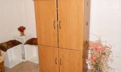 ENTERTAINMENT UNIT- Light oak finish.  2 large cabinet top; 2 cabinet lower.  EXCELLENT CONDITION.  MOVING- MUST SELL!!!!   NORTH KILDONAN area.   mailto:jkaatz@mts.net