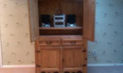 This Armoire is versatile for either an entertainment unit for TV or can be used as a wardrobe.   Solid Wood   High Quality   2 Drawers, 2 cabinet doors above with 2 cabinet doors below