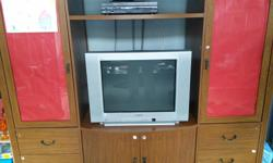 I am giving away a large entertainment unit and Sony TV & DVD player (in perfect working order) The entertainment unit measures 80 wide by 20 deep by 65 high. For full disclosure the left end unit has a small chip out of the side (see 2nd picture) but it