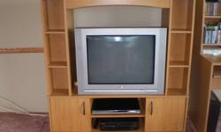 """Entertainment unit holds movies in the front and on the side, is in good condition. $75.00 for entertainment unit (dimensions are: Height: 51"""", Width: 48"""", Depth: 14"""") and $50.00 for the TV (27""""). Will sell together or separate."""