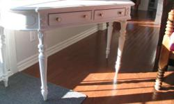 White rustic table available. It has two middle drawers. The table is 34 inches in height. The table is 54 inches long and is 18 1/2 deep.