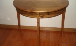 Entry/foyer table comes with shelf underneath and in excellent condition. Great for plants in front window also. Measures 39 x 20 and 29 1/2 inches high.