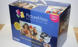 Epson Picture Mate - personal photo lab - Brand New, never been opened. No computer required. Get ready to print those beautiful Christmas photo's you'll be taking.   Amazon selling them for $249...asking $95 Product Features Engineered with digital