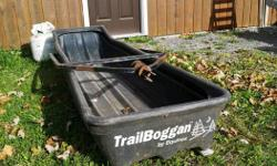 "Equinox Trailboggan snowmobile sled. Heavy duty sled with brand new polyethylene runners. Measures 7' long x 26"" wide x 12"" deep."