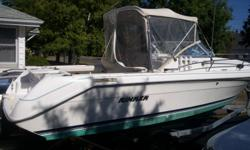 REDUCED: 1994, 24 ft. Rinker Fishing Cuddy with 2006 custom made galvanized Excalibur towing trailer. Currently being stored indoors for the winter. Unit has full canvas top with removable back drop curtain, half mooring and full mooring covers all in