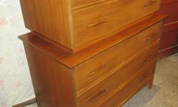IT IS ONE SOLID PIECE. IT HAS FIVE DRAWERS. THE TOP TWO ARE 38 INCHES WIDE AND 19 1/2 INCHES DEEP. THE BOTTOM THREE ARE 41 INCHES WIDE & 21 INCHES DEEP. IN TOTAL IT STANDS 48 INCHES TALL. THE DRAWERS ARE ALL WOOD AND DOVETAILED, THE TOP LARGER DRAWER IS