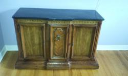 "Solid wood cabinet with marble top. on wheels for easy movement. shelves and drawers. Excellent condition. A beautiful addition to any entry way, family room or space that can use a piece that is functional as well as lovely. length = 43"" width = 17"""