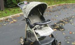 Evenflo stroller for sale, in very good condition. Sage green in colour, has pivoting wheels for easy mobility, cup holders and pockets, and  a storage compartment underneath stroller. $40.00 o.b.o. 905-434-7526