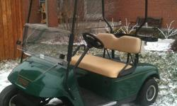 Electric 2006 EZ-GO TXT. Forest Green with Tan Seats, Flip Windshield, Mint Condition. NEW BATTERIES. Only $2595.00+HST Preseason Price. Includes Full Warranty! Only at: Lifestyle Golf Carts and Accessories