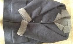 For sale faux suede and shearling coat. Reversible. Brown and a size Medium or large as the tag is not in coat. Will deliver to city. Hardly worn