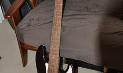 Fender 5 String Jazz Bass (Mexico) with hard shell case. Solid wine colour body. $600 neg