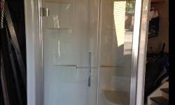 New - never installed fiberglass shower with glass door, as well as built in seat and corner shelf. Measures 47 inches wide, 81 1/2 inches high and 34 1/2 inches deep. Can deliver within reason. Negotiable. Serious inquiries only please call Mike at
