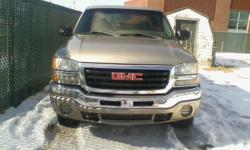Year 2003 Colour silver Trans Automatic Don't want any less than $600. Truck is a 2003 GMC Chev. Needs work and will explain what it needs by phone.