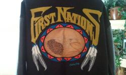 A First Nations Dress or sport coat. Leather sleeves with wool body. Leatherwork and lettering on back Embroidered on front.