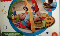 NEW PRICE 7/16/13 The Luv U Zoo is a tri-arch plastic gym with a soft quilt with the fun Luv U Zoo characters and 4 repositionable toys. There is a musical pull-down mirror (has three musical diddies), an elephant with a rattle rollerball, a rhino with