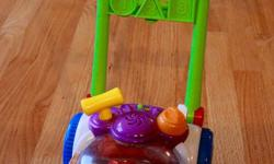 Push and pop mower toy