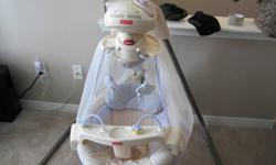 Plays music, has a mobile that has stars in it that makes a sihouette for the baby to watch. swings both front wards and sideways, battery powered, OR you can plug it into the wall which saves a ton on batteries, comes from a pet free and smoke free