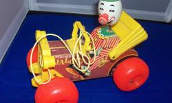 These vintage Fisher Price toys are in used but good condition. Wear and tear would be as expected for a well loved child's toy. Delivery can be negoiated in Muskoka. All contact by email please.