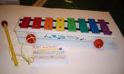 WITH color coordinated music book, baton, cord.