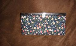 This wallet was purchased for over double the price of what i'm trying to sell it however it is still in perfect condition! This would make a great gift for a friend, girlfriend, sister etc! please email me if interested, price IS negotiable!