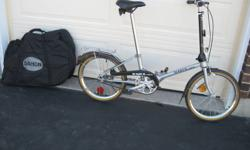 2 Dahon RV-Mate 3 speed Folding Bicycles and travel  carry bag. { Bike new 500.00 ea}  .{ bag new 50.00ea }  Asking 200.00 ea  or both bikes $350.00