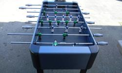 Foosball table in excellent condition with extra balls.Electronic score board.